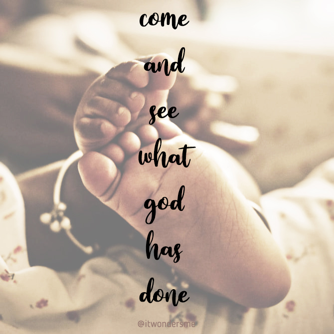 """""""Come and see what God has done."""" Close up of a pair of brown baby feet with anklet."""