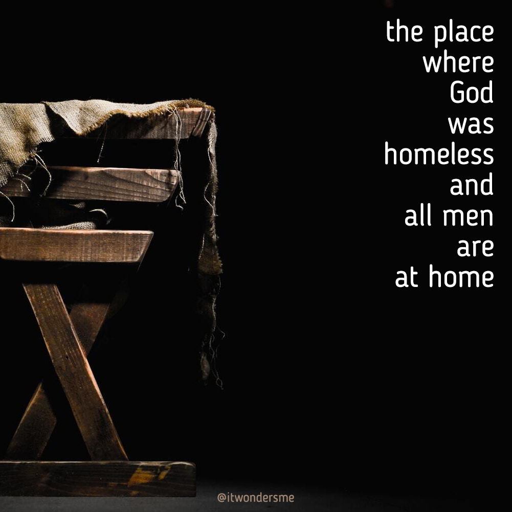 """The place where God was homeless and all men are at home."" A manger with a blanket on the side."