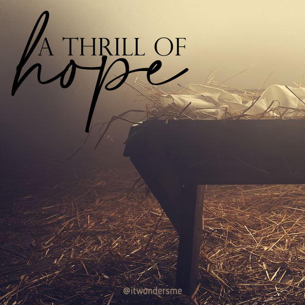 """A thrill of hope"" A barn with a manger in soft light."