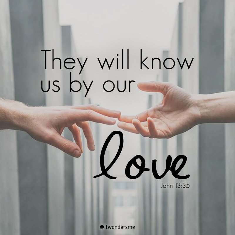 """""""They will know us by our love."""" Two hands reaching towards each other."""