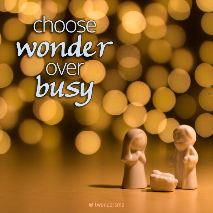 Choose wonder over busy. Sparkle bokeh background with small simple nativity scene.