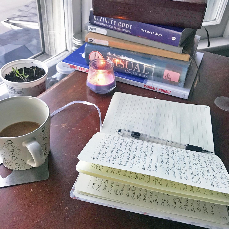 Open prayer journal on desk