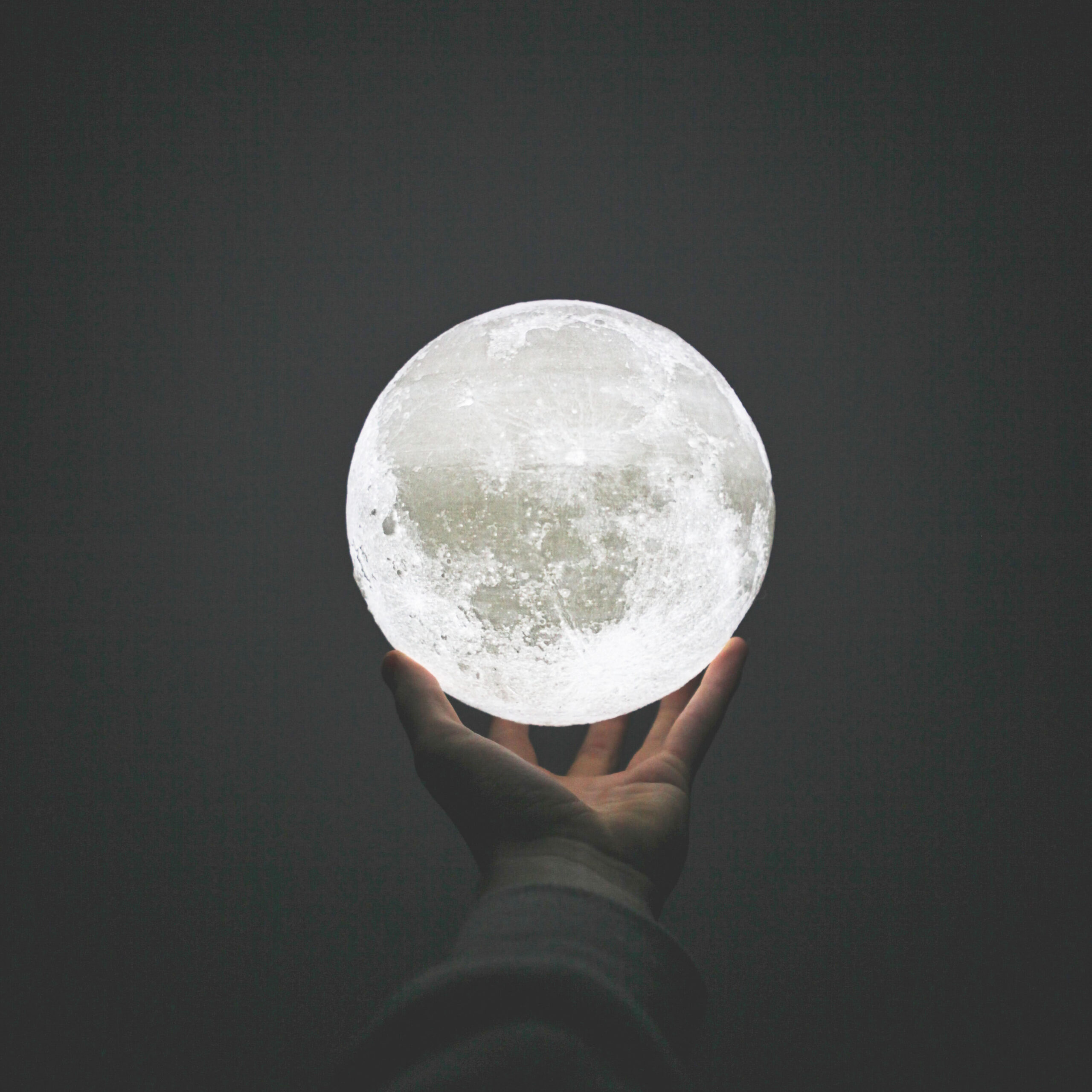 Holding-the-moon-Jasper-Benning-via-Unsplash